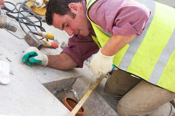 Man Working on Drain Repairs